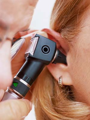Doctor looking in an ear