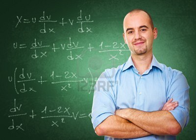 Math teacher at chalkboard